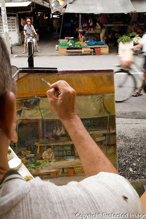 A George Town artist captures the old Campbell Street market on canvas.