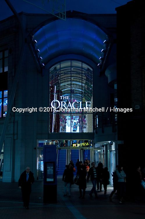 Shoppers at an entrance to The Oracle shopping centre, Reading, Berkshire, England, 13 November 2013. Picture by Jonathan Mitchell / i-Images
