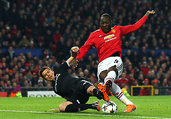 Romelu Lukaku of Manchester United is tackled by Clement Lenglet of Sevilla - Mandatory by-line: Robbie Stephenson/JMP - 13/03/2018 - FOOTBALL - Old Trafford - Manchester, England - Manchester United v Sevilla - UEFA Champions League Round of 16 2nd Leg
