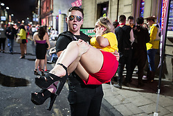 © Licensed to London News Pictures . 27/12/2015 . Wigan , UK . Revellers in Wigan enjoy Boxing Day drinks and clubbing in Wigan Wallgate . In recent years a tradition has been established in which put on fancy dress for a Boxing Day night out . Photo credit : Joel Goodman/LNP