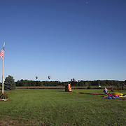 Peter Wright, Australia and his crew pack their hot air balloon after landing during practice day for the World Hot Air Ballooning Championships in Battle Creek, Michigan, USA. 17th August 2012. Photo Tim Clayton