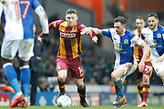Bradford City striker Shay McCartan (14) and Blackburn Rovers midfielder Corry Evans (29) during the EFL Sky Bet League 1 match between Blackburn Rovers and Bradford City at Ewood Park, Blackburn, England on 29 March 2018. Picture by Craig Galloway.