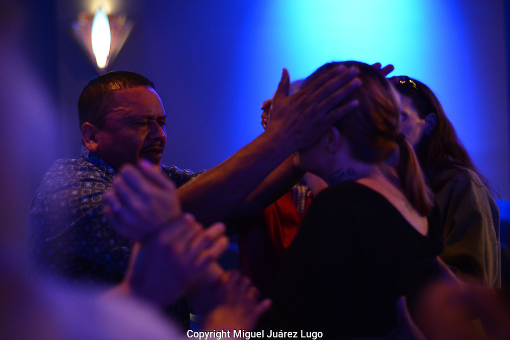 "Pastor Juan Hernandez prays with Chasity Holt, a heroin addict who showed up saying that she had overdosed only the day before--as she put it, ""I died yesterday."" Hernandez works with head pastor Billy Price, who has devoted his ministry, City on a Hill church, to helping heroin addicts in the Cincinnati, Ohio area, where heroin use is rampant, part of a growing epidemic across the U.S."