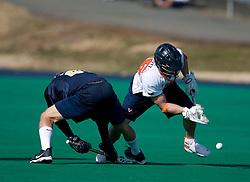 Virginia midfielder Brian Mcdermott (26) wins a face off against Navy.  The Virginia Cavaliers scrimmaged the Navy Midshipmen in lacrosse at the University Hall Turf Field  in Charlottesville, VA on February 2, 2008.