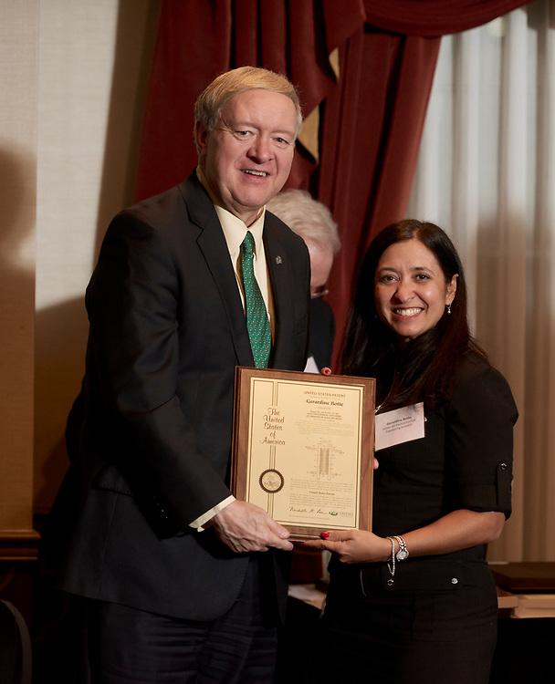 President Nellis presents Gerardine Botte her patent award.
