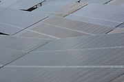 A close up view of photovoltaic solar panels at different angles in a field for electricity production.Salhouse Solar Park has an electrical output of 4.987 MW saving emissions of 4890 tonnes of C02 per year. Norfolk. UK.(photo by Andrew Aitchison / In pictures via Getty Images)