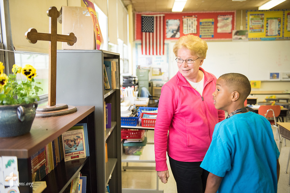 Teacher Nancy Spitzack and student Josiah Knox talk together near the end of class at Lutheran Special School & Education Services, located in Milwaukee Lutheran High School, on Tuesday, May 19, 2015, in Milwaukee, Wis. LCMS Communications/Erik M. Lunsford