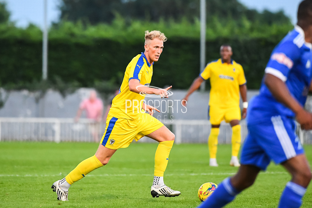 AFC Wimbledon Midfielder Mitchell Pinnock (11) in action during the Friendly match between Metropolitan Police and AFC Wimbledon at Imber Court, Molesey, United Kingdom on 23 July 2019.