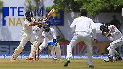 July 26, 2017 - Galle, Sri Lanka - Indian cricketer Cheteshwar Pujara(L) plays a shot as Sri Lanka's Kusal Mendis(R) reacts during the 1st Day's play in the 1st Test match  (Credit Image: © Tharaka Basnayaka/NurPhoto via ZUMA Press)