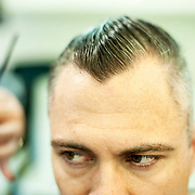 May 2, 2012 - Manhattan, NY : Musician and composer Michael Arenella has his hair cut -- as he has for the past 8 years -- at 'Hair Box,' located at 203 Spring Street in Manhattan, on Wednesday afternoon. His cut, which he characterizes as an old-fashioned military-style 'do, is certainly vintage, according to his barber Georgiy Ibragimov (not clearly  pictured). CREDIT: Karsten Moran for The New York Times