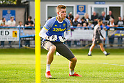 Leeds United goalkeeper Bailey Peacock Farrell (1) warming up during the Pre-Season Friendly match between Guiseley  and Leeds United at Nethermoor Park, Guiseley, United Kingdom on 11 July 2019.