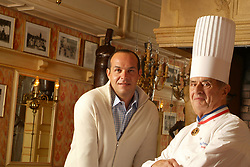 "Collonges au Mont d'Or (69) : Le chef etoile Paul Bocuse, surnomme ""Le Pape de la cuisine"" chez lui a l'Auberge du pont de Collonges, ici accompagne de son fils, Jerome, chef cuisinier qui preside le Sirha, salon international de l'hotellerie, la restauration et l'alimentation organise a Lyon. (Mars 2006) High cuisine chef Paul Bose died at 91 it was announced on Saturday. Photo by Soudan/ANDBZ/ABACAPRESS.COM"