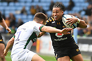 Wasps winger Marcus Watson (15) hands off London Irish wing Ollie Hassell-Collins (11) during the Gallagher Premiership Rugby match between Wasps and London Irish at the Ricoh Arena, Coventry, England on 20 October 2019.