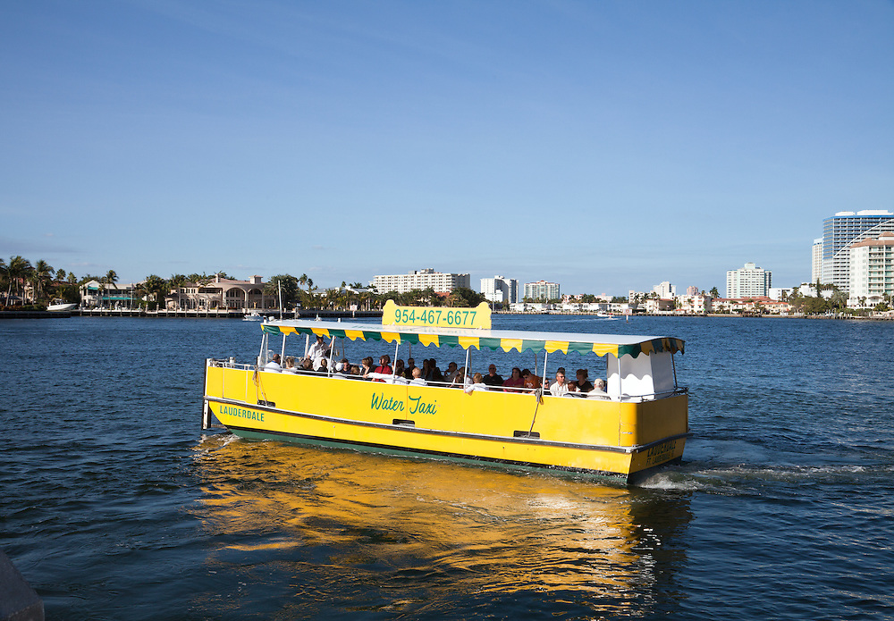Ft. Lauderdale, FLorida: Water taxis take sightseers as well as residents to various points on the Intracoastal Canal and New River, both of which form an inside waterway that parallels Ft. Lauderdale Beach.