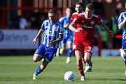 Jay Spearing of Blackpool goes past Dion Charles of Accrington during the EFL Sky Bet League 1 match between Accrington Stanley and Blackpool at the Fraser Eagle Stadium, Accrington, England on 21 September 2019.