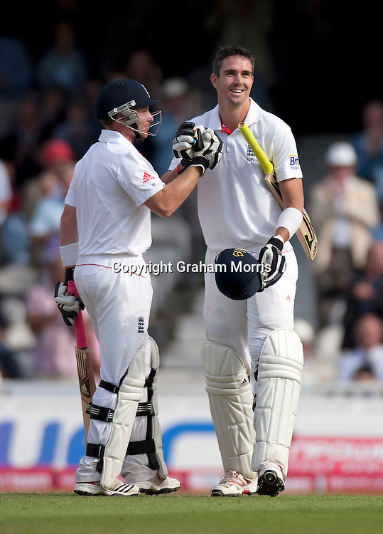 Kevin Pietersen celebrates his century (with Ian Bell, left) during the fourth and final npower Test Match between England and India at the Oval, London.  Photo: Graham Morris (Tel: +44(0)20 8969 4192 Email: sales@cricketpix.com) 19/08/11