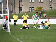 FC Kettledrum's Jake Davidson puts them 1-0 up against Charleston (yellow) in the Dundee Saturday Morning Football League George Mcarthur Memorial Cup Final at Glenesk, Dundee, Photo: David Young<br /> <br />  - &copy; David Young - www.davidyoungphoto.co.uk - email: davidyoungphoto@gmail.com