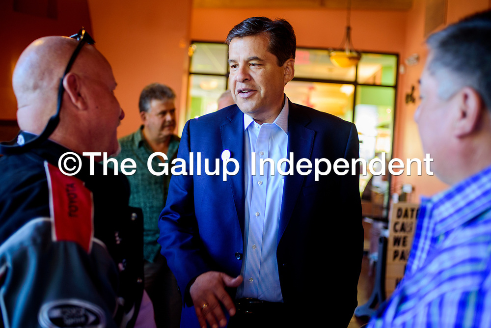 Gubernatorial candidate Joe Cervantes, center, greets Bill Lee, left, and George Munoz during a campaign stop at Camille's Sidewalk Cafe in Gallup Monday.