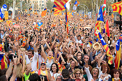 "People wave ""estelada"" or pro-independence flags, outside the Palau de la Generalitat in Barcelona, Spain, on Friday, October 27, 2017, after Catalonia's regional Parliament passed a motion it says establishes an independent Catalan Republic. Photo by Almagro/ABACAPRESS.COM"