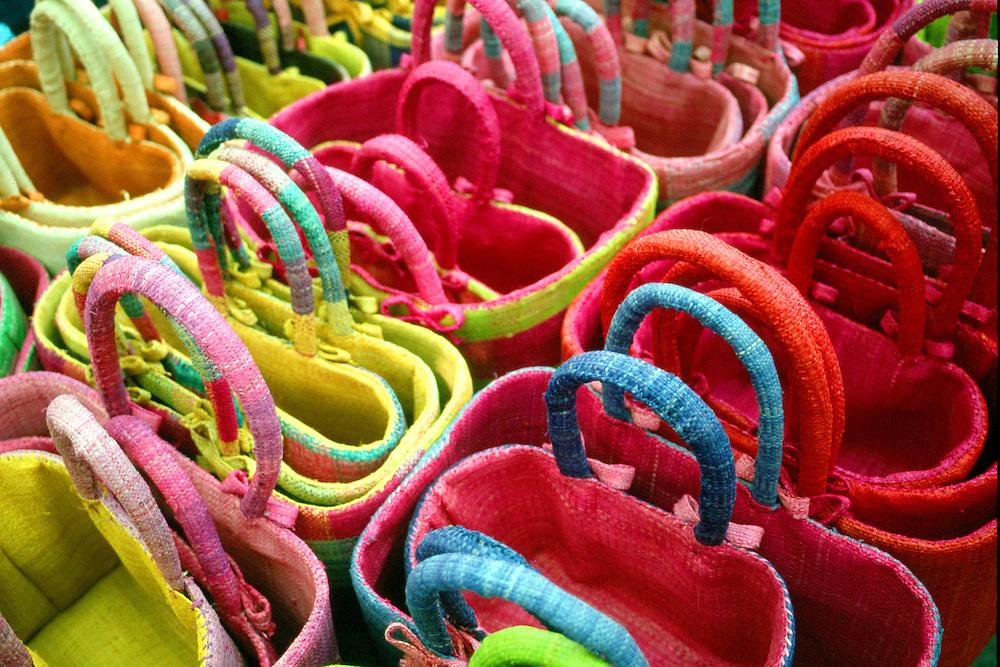 Multi-coloured straw baskets at open air market, L'Isle sue la Sorgue, France