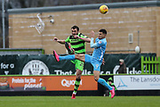Forest Green Rovers Farrend Rawson(20) clears the ball under pressure from Coventry City's Jordan Willis(4) during the EFL Sky Bet League 2 match between Forest Green Rovers and Coventry City at the New Lawn, Forest Green, United Kingdom on 3 February 2018. Picture by Shane Healey.