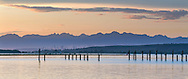 Blackie Spit, Boundary Bay, Burnaby's Metrotown and the North Shore (Pacific Coast Range) Mountains.  Photographed from Blackie Spit in Surrey, British Columbia, Canada
