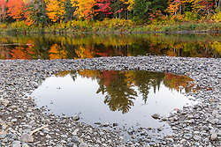 Fall colors line the banks of the East Branch of the Penobscot River in Maine's Northern Forest.