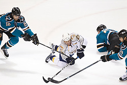 January 8, 2011; San Jose, CA, USA; Nashville Predators center Jerred Smithson (25) dives for the puck between San Jose Sharks center Patrick Marleau (12) and center Joe Thornton (19) during the first period at HP Pavilion. Mandatory Credit: Jason O. Watson / US PRESSWIRE