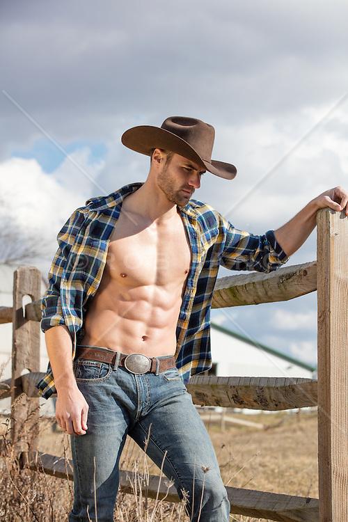 muscular cowboy with an open shirt
