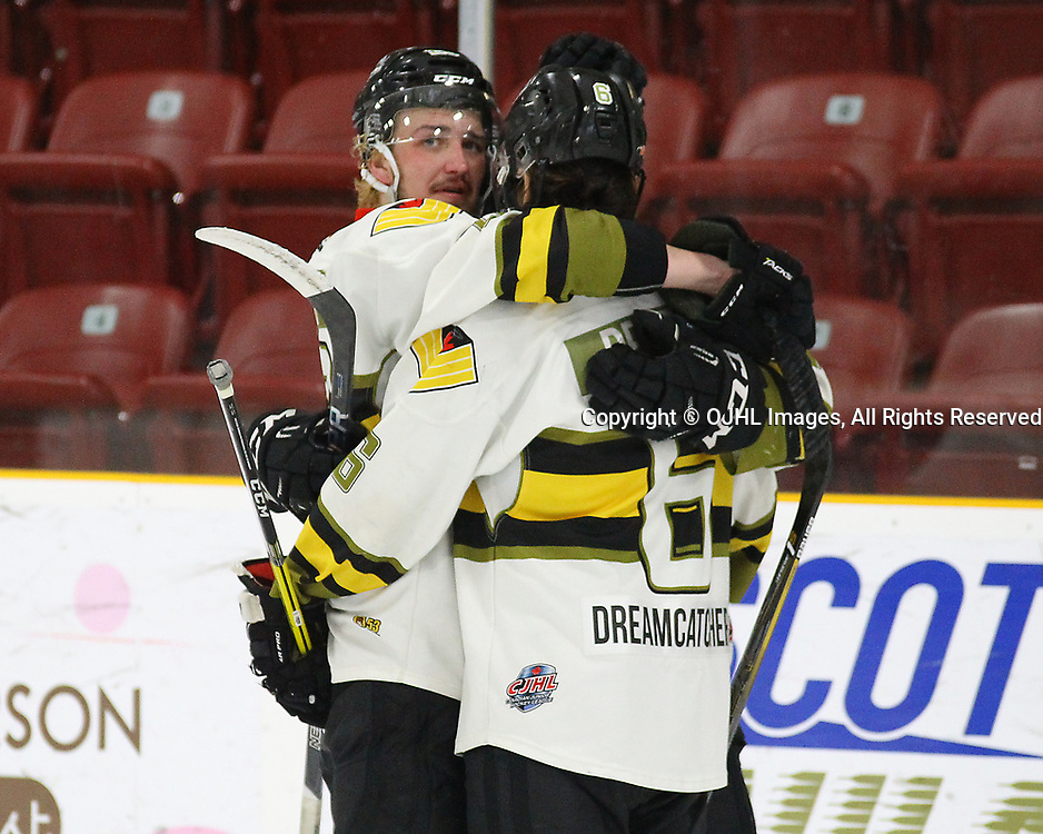 TRENTON, ON  - MAY 5,  2017: Canadian Junior Hockey League, Central Canadian Jr. &quot;A&quot; Championship. The Dudley Hewitt Cup Game 7 between Georgetown Raiders and the Powassan Voodoos.    Dayton Murray #20 and  Bo Peltier #6 of the Powassan Voodoos hug post game. <br /> (Photo by Alex D'Addese / OJHL Images)