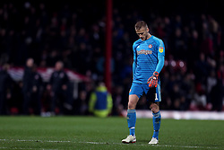 Brentford goalkeeper Daniel Bentley looks dejected at full time