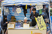 A support station offering water, tissue paper and other necessities. Protesters known as the Umbrella Revolution or Occupy Mongkok, an extension of the larger Occupy Central movement, have taken over a number of blocks on the busy road and staged an ongoing demonstration calling for universal suffrage for Hong Kong.