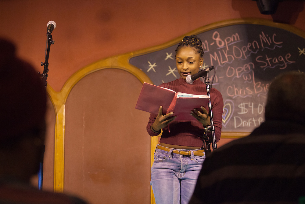 "Kaitlin C. Wilson reads a poem at ""Creative Arts as Activism – Social Justice-Themed Open Mic Night,"" at Casa Nueva Restaurant and Cantina on January 20, 2016. Wilson was also the emcee for the event. ©Ohio University/Photo by Kaitlin Owens"
