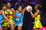 Fijian goal defence Kelera Nawai try to defend a shot on goal by Jamaica during the 2019 Netball World Cup match between Jamaica and Fiji at M & S Bank Arena, Liverpool, United Kingdom on 12 July 2019.