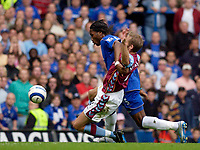 Photo: Daniel Hambury.<br /> Chelsea v Aston VIlla. The Barclays Premiership.<br /> 24/09/2005.<br /> Chelsea's Didier Drogaba is tackled by Villa's Olof Mellberg for the penalty that give Chelsea the win.