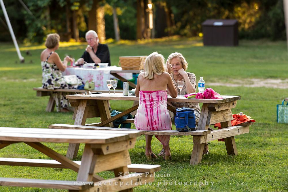 Picnicking and enjoying the sounds  at Caramoor in Katonah New York on July 22, 2016. <br /> (photo by Gabe Palacio)