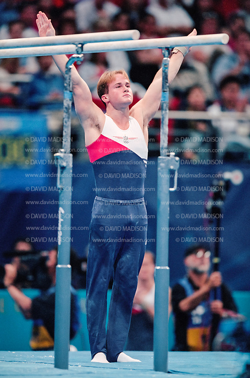 SYDNEY - SEPTEMBER 1:  Paul Hamm of the United States competes on the parallel bars during the Men's Gymnastics events of the Olympic Games during September 2000 in Sydney, Australia.  (Photo by David Madison/Getty Images)