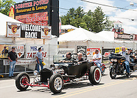 Kerry Morrison drives through Weirs Beach in his hot rod on Friday afternoon.  (Karen Bobotas/for the Laconia Daily Sun)