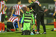 Forest Green Rovers Christian Doidge(9) receives treatment from Forest Green Rovers physio Joe Baker during the EFL Sky Bet League 2 match between Forest Green Rovers and Lincoln City at the New Lawn, Forest Green, United Kingdom on 12 September 2017. Photo by Shane Healey.