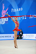 Zhang Doudou during qualifying at ribbon in Pesaro World Cup at Adriatic Arena on 11 April 2015. Doudou was born on July 23, 1996 in Taiyuan. She is a Chinese individual rhythmic gymnast.