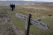 Walkers descend from the summit of Pen-y-Ghent in the Yorkshire Dales National Park, on 13th April 2017, in Horton in Ribblesdale, Yorkshire, England.