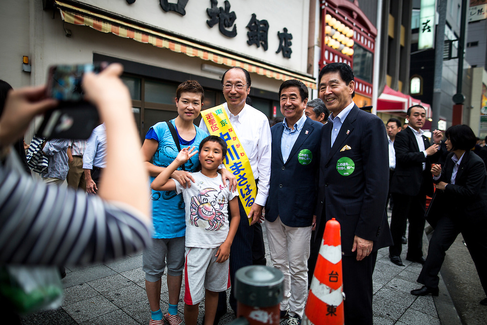 TOKYO, JAPAN - JULY 9 :  Masaharu Nakagawa a candidate from Liberal Democratic Party (LDP) take photos with supporters during the last day of 2016 Upper House election campaign outside of Asakusa Station in Tokyo, Japan on July 9, 2016. Tomorrow, July 10, 2016 will be the first Upper house election nation-wide in Japan that 18 years old can vote after Japanese government law changes its voting age from 20 years old to 18 years old. (Photo by Richard Atrero de Guzman/NURPhoto)