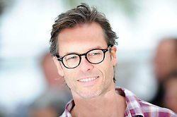 Australian actor Guy Pearce poses during the photocall of 'Lawless' presented in competition at the 65th Cannes film festival on May 19, 2012 in Cannes. Photo by Ki Price/i-images