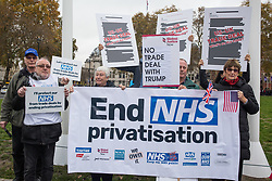 London, UK. 25 November, 2019. Campaigners from Keep Our NHS Public, Health Campaigns Together, We Own It and Global Justice Now protest in Parliament Square to call on Prime Minister Boris Johnson to end privatisation of healthcare in the National Health Service (NHS).