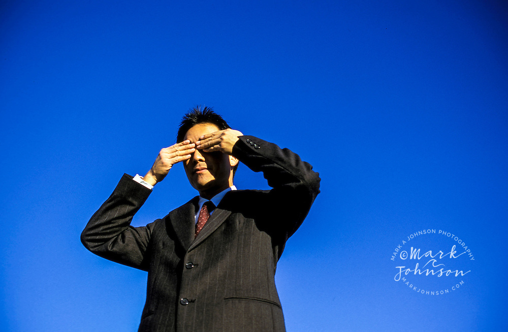 See no evil-businessman covering his eyes