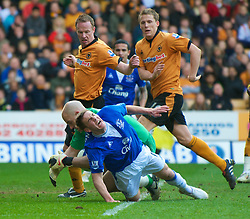 WOLVERHAMPTON, ENGLAND - Saturday, March 27, 2010: Everton's Dan Gosling is lucky to get away without a broken leg as Wolverhampton Wanderers' goalkeeper Marcus Hahnemann lands on his right leg during the Premiership match at Molineux. (Photo by David Rawcliffe/Propaganda)