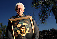 BRENDAN FITTERER  |  Times.PT_317144_FITT_faith (01/14/2009 Port Richey) (IMAGING NOTE: PLEASE PRESERVE SHADOWS AND DEEP COLOR SATURATION FROM LIGHTING).Artist Lyndon Scheeren_1 holds one of his paintings of Jesus done in watercolor. Much of his energy these days goes into the faith cards he gives away, that feature a meticulous pencil drawing on the front and a prayer on the back..BRENDAN FITTERER  |  Times