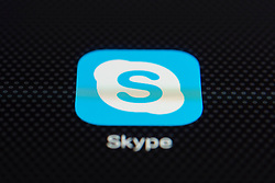 Skype online internet calling app close up on iPhone smart phone screen
