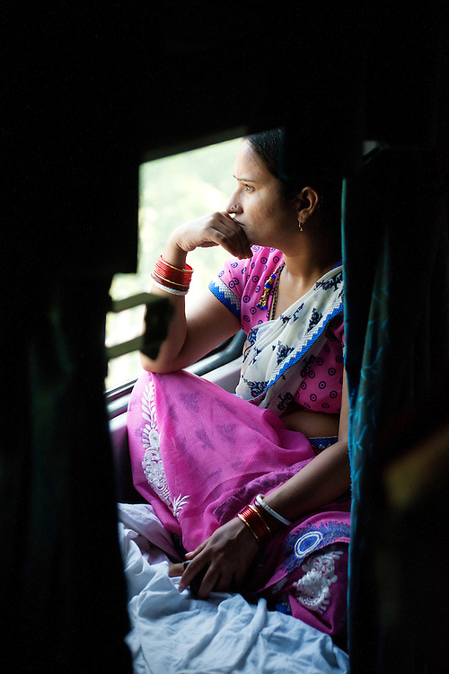 Portrait of an Indian lady on a train in deep thought