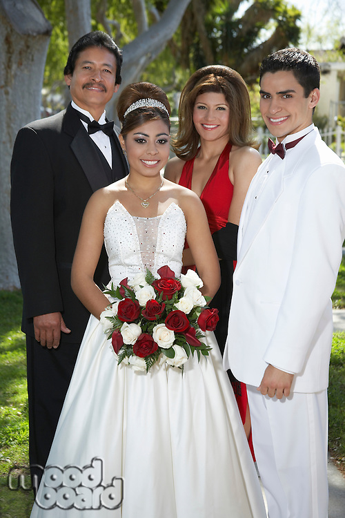 Portrait of wedding couple with parents